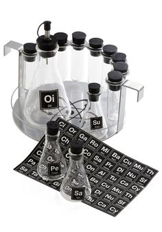 Elemental, My Dear Spice Rack Set. As an organic chemist, you put your lab skills to good use while experimenting in the kitchen with this spice rack set, available for purchase in September. #multi #modcloth