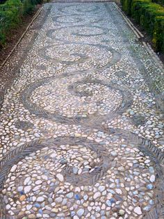 Stone mosaic path from the Alhambra Palace Gardens in Granada, Spain