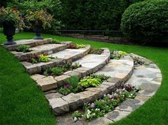 Stone steps with integrated flower beds, urns at top