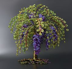 Seclusion by Twysted Roots - Weeping floral style tree with hanging purple bead clusters with light green bead leaves, twysted together with coloured copper wire.