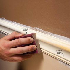 Sand Trim Between Coats for an Ultra-Smooth Finish - Our best tips for painting trim perfectly Get tips: http://www.familyhandyman.com/painting/tips/trim-painting-tips-for-smooth-and-perfect-results