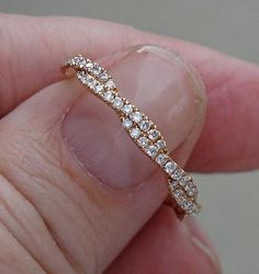 Eva is 18K and carefully crafted with 88 pave set diamonds, weighing approximately .50 cttw. This a unique piece that can be worn alone or