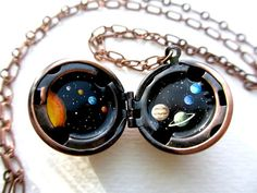 Solar System Locket: this etsy shop has absolutely lovely hand painted lockets. I want them all!