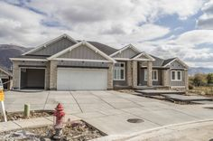 The Ensemble Plan with a Craftsman exterior built and designed by Symphony Homes in North Salt Lake, Utah 801-298-8555