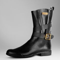 Authentic Burberry Rain Boots Super cute and perfect for fashion meets function! Recently conditioned, starting to turn slightly grey like most rain boots do. Otherwise in excellent pre worn condition. Size 36, would fit up to a size 7. Gold buckle detail. No trades!! 022116150gwb Burberry Shoes Winter & Rain Boots