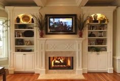 Bookcase Fireplace Mantel Built In | Stone fireplace, built-in bookcase and arched wood mantel.