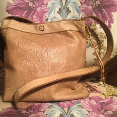 Vintage Style Leather Crossbody Genuine leather tan cross body bag. Comftorable strap that measures 43 inches long. Magnetic snap closure with a zipper pocket inside. This Is perfect for your spring/summer bag because it will go with everything with its neutral color and looks Amazing!! PRICE FIRM Lucky Brand Bags Crossbody Bags