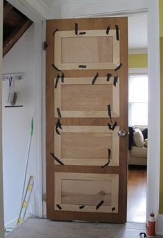 diy door paneling, think this might be easier and with a lot less tape used if the door was taken down !??
