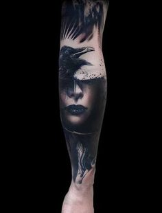 Awesome portrait of a woman and raven tattoo on forearm