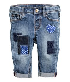 5-pocket jeans in washed stretch denim. Adjustable elasticized waistband, fly with snap fastener, appliqués at front, and contrasting back pocket. #Baby #girls #pants