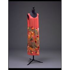 This mid-calf evening dress is made of multi-coloured silk and velvet appliqué on red silk. Natalia Goncharova designed it for the Maison Myrbor in Paris about 1923