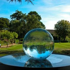 Enchanted ✨ with the reflections of the surrounding elements 🌳☀️The blues and greens in the sphere 🔮 are magical! Order yours today www.allisonarmour.com #spherefountain #gardendesign #gardenart #landscapedesign #waterfountain #waterfeature #luxurydesign #luxuryliving #gardendesignmag #orbfountain #gardensculpture #outdoorlivingspace #luxe #homesandgardens #houseandgarden #betterhomesandgardens #outdoorfountain #indoorfountain #gardenfountain #gardenwaterfeature #aqualens Landscape Design, Garden Design, Indoor Fountain, Water Features In The Garden, Outdoor Areas, Better Homes And Gardens, Luxury Living, Garden Sculpture, Reflection