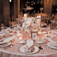Brides.com: A Glamorous Winter Wedding in Chicago. Tables were topped with champagne linens, candles, and centerpieces of roses, orchids, ranunculuses, and branches. All flowers were by Blumen Floral & Event Design. #weddings #wedding #marriage #weddingdress #weddinggown #ballgowns #ladies #woman #women #beautifuldress #newlyweds #proposal #shopping #engagement