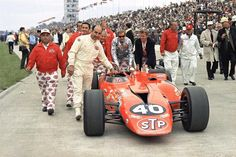 Crew members push the STP-Paxton turbine-powered car of Parnelli Jones before the 51st running of the Indy 500 at Indianapolis Motor Speedwa...