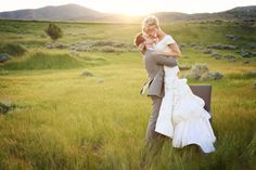 the kiss....dress...landscape ---<3 What more could a girl ask for?   Wedding Photography to Inspire