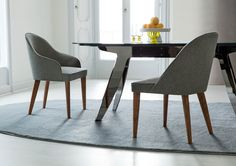 DINING ROOM   Judy fabric chair and Ring table black chromed steel base.