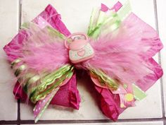 Girly Pink and Green Bowtique Bow by HodgePodgeBowtique on Etsy, $8.50
