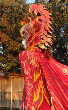 My Halloween costume was a mythological phoenix, the colorful red and gold bird that bursts into flames and is reborn from its own ashes. This costume consumed all.
