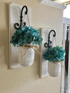 These rustic country style mason jar sconces are the perfect touch to your home decor. They bring warmth and beauty to any room. This listing is for 2 Sconces so for each quantity of one at checkout you are ordering one set of 2. Jars are pint size.  {{{{{JARS ARE PAINTED IN ANTIQUE WHITE}}}}  Scroll through the listing to see your sconce finish/flower/jar paint color options. The Sconce pictured is done in Antique White the Jars are done in Antique White as well.  (Flowers are opti...
