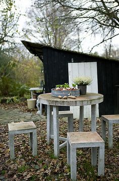 black and white shed + concrete furniture.