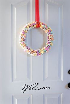 Conversation heart wreath to make for vday?..looks like a lot of hot glue gun burns but cute