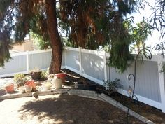 Grey/white Vinyl Fence installed in Canyon Lake Ca fence for all you vinyl fence needs Murrieta/Temecula area fence company