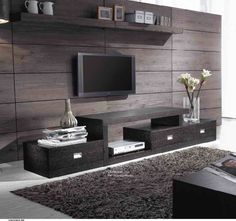 Modern wood paneling. love the dark wood and you could fit a large TV in there. amazing