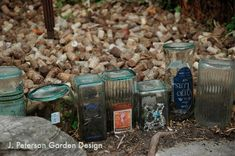 flower bed edged with clear bottles, with mulch from wine corks