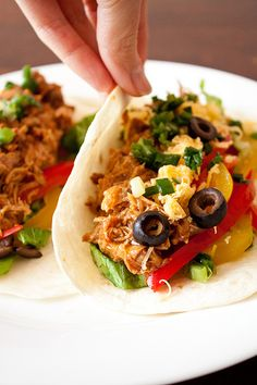 Mexican pulled pork tacos... this girl has awesome recipes and she already modifies them so they're a lil' healthier