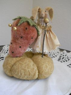 Simply Adorable OOAK Primitive Bunny with Strawberry Pin Cushion.   Made by hand. Photo via ebay. { I ended up buying it ...lol }
