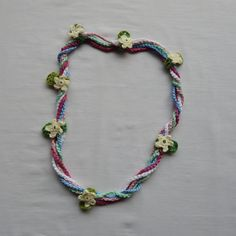 Fun multi strand colorful necklace with adjustable flowers. You can choose whether you want to spread the flowers across the whole necklace or to