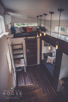 Love the two sleeping spaces/lounge and master loft, with the open concept and the gorgeous hanging lights. Many Faces of hOMe - TinyHouseBuild.com