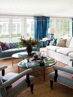 In the family room, a French-inspired sofa with Indian embroidered pillows keeps company with a vintage hanging lantern and custom Morris ar...
