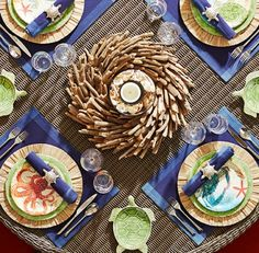 A driftwood wreath is used as a centerpiece on this nautical table setting: http://www.completely-coastal.com/2016/05/5-coastal-nautical-theme-table-settings.html  Any wreath can make a great table centerpiece. You can place a vase or jar in the center with a candle....