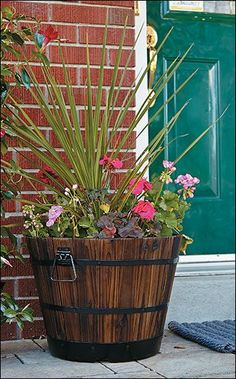 Using a whiskey barrel planter is an ingenious way of container gardening. What a spectacular way to practice green gardening. Why might you ask? Wood Barrel Planters, Whiskey Barrel Planter, Garden Planters, Growing Flowers, Planting Flowers, Barrel Flowers, Genius Ideas, Outdoor Flowers, Garden Yard Ideas
