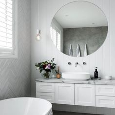 Herringbone tile feature wall using opal subway tiles, soft concrete look tiles with marble top vanity 👌. Contemporary Hampton's bathroom. Marble Tile Bathroom, Laundry In Bathroom, Bathroom Renos, Bathroom Feature Wall Tile, Bathroom Ideas, Lodge Bathroom, Marble Tiles, White Tiles, Marble Top