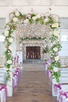 Whimsical ceremony decor idea - greenery + floral archway with purple ribbon aisle markers  {Tina Elizabeth Photography}