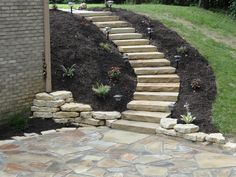 Flagstone steps from the front porch to the sidewalk, along the driveway.