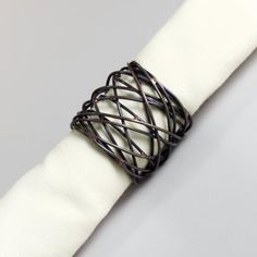 What we love about this wrapped-metal napkin ring is that it takes familiar fall elements, like the sight of handwoven baskets and bare branches outside, and translates them into this simple but elegant representation.
