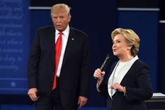 Democratic presidential candidate Hillary Clinton can be seen wearing a small white lapel mic while Republican presidential candidate Donald Trump is not, at Washington University in St. Louis, Missouri, on October 9, 2016