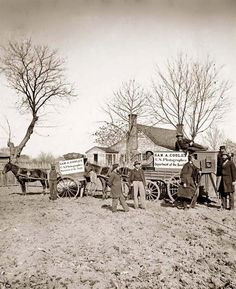 Wagons and camera of Sam A. Cooley, U.S. photographer, Department of the South. It was taken between 1860 and 1865.