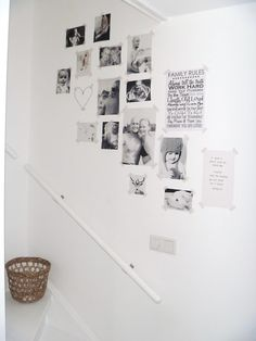 Pictures in black and white in the hallway #washitape #stairs #white