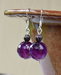 12mm Purple Agate Gemstones and 5mm Blue Iris Czech Glass Melon Beaded earrings with 925 Sterling Silver ear wires.