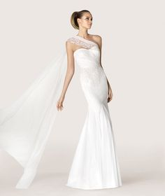 Pronovias Barcelona - ANTIC COLLECTION 2015 Modern Bride Flared tulle wedding dress with gemstone embroidery. Bodice with sweetheart neckline with cape-effect embroidered tulle. Flared skirt
