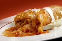 Stuffed Cabbage - cabbage leaves stuffed with spicy minced meat, and sour cream on the top. Goood!