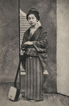 Geisha with shamisen, ca.1863-1876 by Shimooka Renjo