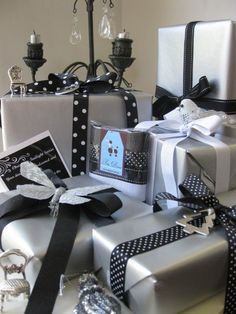 my husband's idea for next year, He wants black and white silver Christmas decors & gifts!I love his ideas! I told him let's combine colors too. like gold or semi goldish. Black Christmas, Christmas Ribbon, Noel Christmas, Christmas Gift Wrapping, Christmas Gifts, Christmas Mantles, Elegant Christmas, Christmas Villages, Victorian Christmas