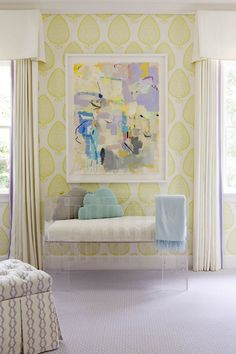 First of all, that lucite crib is our dream. Second, we're smitten with this light lemon wallpaper and art combo.