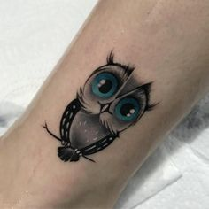 80 Coolest 3D Owl Tattoo Art Design Ideas: Small Cute Owl With Blue Eyes On The Beach Tattoo