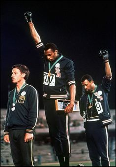 African American athletes Tommie Smith and John Carlos performed their Black Power salute at the Summer Olympics in Mexico City (1968)